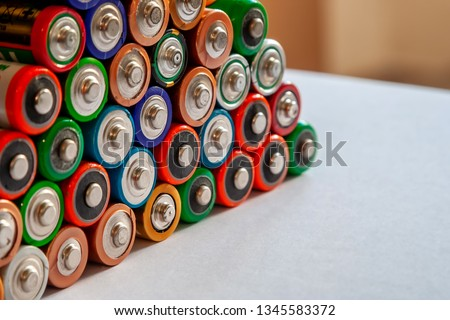 Closeup of pile of used alkaline batteries. Several  in rows. #1345583372