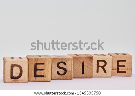 wooden cubes on a white background and the word laid down #1345595750