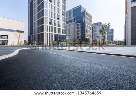 Panoramic skyline and modern business office buildings with empty road,empty concrete square floor #1345764659