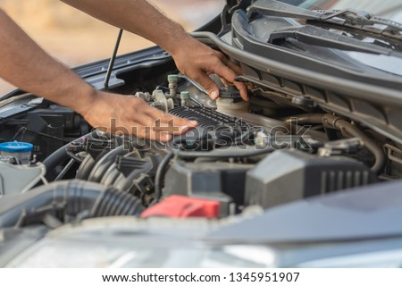 Auto mechanic working in garage. Repair service.  #1345951907
