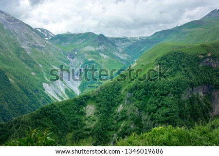 A caucasian mountain landscape. A valley and a green pasture. The Georgia, Caucasus. #1346019686