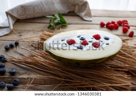 Raw ice cream with fruit in melon #1346030381