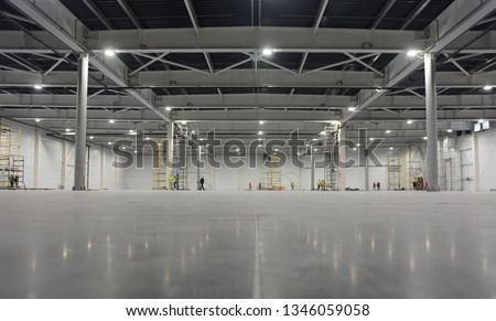 Large modern empty storehouse. Warehous building construction. Industrial warehouse interior. #1346059058