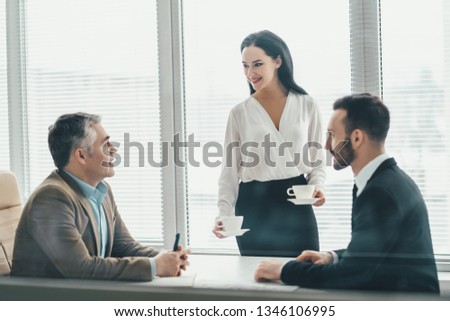 The business people sitting at the office table #1346106995