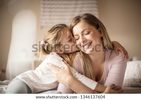 Nothing is greater than love for the mother. Mother daughter on bed. #1346137604