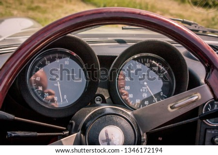 ROME, ITALY 22 MARCH 2019: Dashboard with indicators of an Alfa Romeo GT 1300 Junior exposed to a Vintage car rally #1346172194
