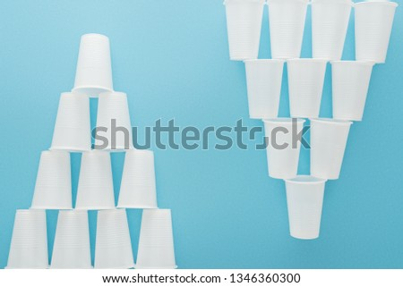 flat lay with white plastic cups isolated on blue with copy space #1346360300