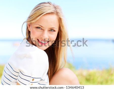 Young attractive woman near the ocean on a summer day #134640413