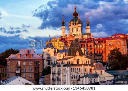Kiev, Ukraine, view of St Andrew's Church on historical Andrew's Descent street in dramatical sunset light #1346450981