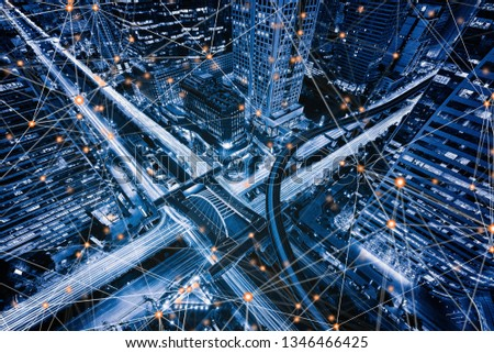 Digital network connection lines of Sathorn intersection, Bangkok Downtown, Thailand. Financial district and business centers in smart urban city in Asia. Skyscraper and high-rise buildings at night. Royalty-Free Stock Photo #1346466425