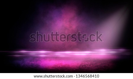 Wet asphalt, reflection of neon lights, a searchlight, smoke. Abstract light in a dark empty street with smoke, smog. Dark background scene of empty street, night view, night city. #1346568410