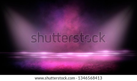 Wet asphalt, reflection of neon lights, a searchlight, smoke. Abstract light in a dark empty street with smoke, smog. Dark background scene of empty street, night view, night city. #1346568413