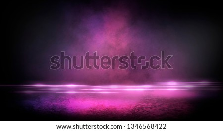 Wet asphalt, reflection of neon lights, a searchlight, smoke. Abstract light in a dark empty street with smoke, smog. Dark background scene of empty street, night view, night city. #1346568422