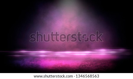 Wet asphalt, reflection of neon lights, a searchlight, smoke. Abstract light in a dark empty street with smoke, smog. Dark background scene of empty street, night view, night city. #1346568563