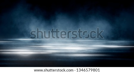 Empty street scene background with abstract spotlights light. Night view of street light reflected on water. Rays through the fog. Smoke, fog, wet asphalt with reflection of lights. Blue and pink neon #1346579801