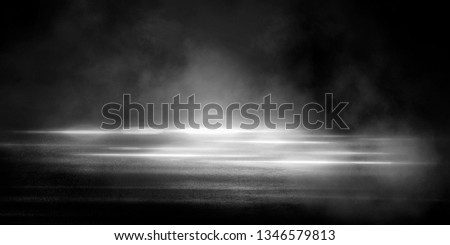 Empty street scene background with abstract spotlights light. Night view of street light reflected on water. Rays through the fog. Smoke, fog, wet asphalt with reflection of lights. Blue and pink neon #1346579813