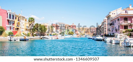 Port Sa Playa, Valencia, Spain - 3/19/2019: Bright sunny day photo looking at Port Saplaya, Valencia's Little Venice  #1346609507
