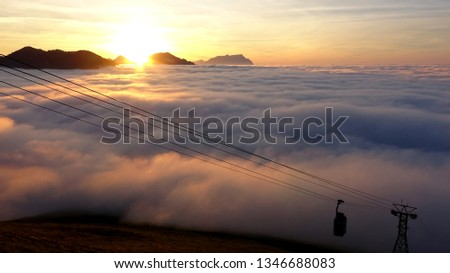 Cable Car above the Clouds #1346688083