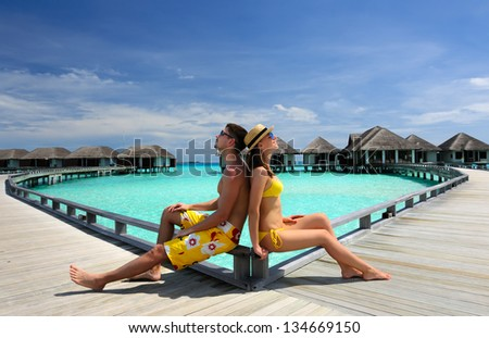 Couple on a tropical beach jetty at Maldives #134669150