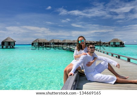 Couple on a tropical beach jetty at Maldives #134669165