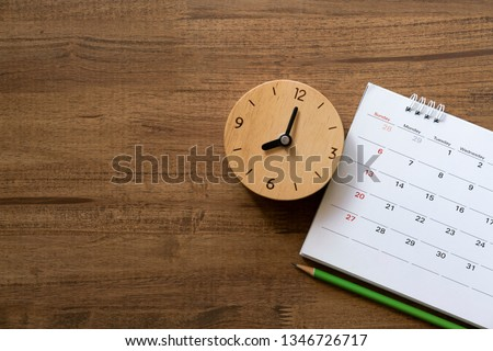 close up of calendar and clock on the table, planning for business meeting or travel planning concept #1346726717