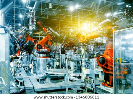 Large automated robotic arm in a car manufacturing plant #1346806811