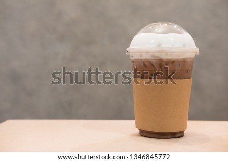 Iced cocoa in takeaway cup on table in coffee shop #1346845772