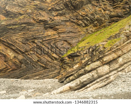 The amazing rock formations in the cliffs at Millook Haven , one of the top 10 geological sites in Britain due to the chevron folds embedded in the cliff face. Royalty-Free Stock Photo #1346882315