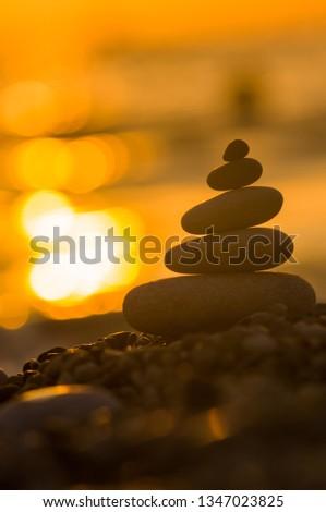 stack of zen stones on pebble beach #1347023825