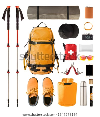 Set of sport equipment and gear for hiking and trekking. Top view of walking sticks, backpack, clothes etc. isolated on white background #1347276194