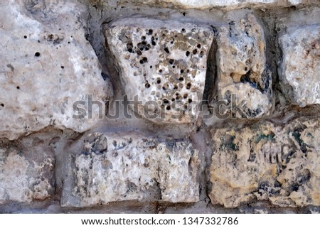 Masonry Rock Wall Texture.  Texture of a fragment of a wall of an old structure. #1347332786