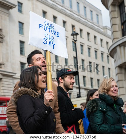 "London, UK. 23rd March 2019. Young couple protestors hold the banner ""Our Future Our Say"" during the People's Vote march in London. #1347383768"
