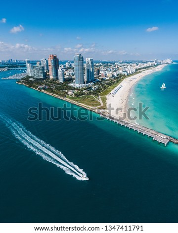 Aerial view of Miami Beach with speedboat in view #1347411791