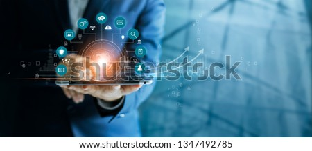 Businessman using tablet analyzing sales data and economic growth graph chart, Technology and icon customer global network connection. Business strategy. Innovative. Digital marketing. #1347492785