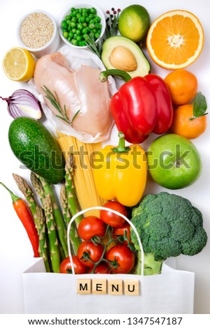Healthy eating background. Healthy food in paper bag meat, fruits, vegetables and pasta on white background. Shopping food in supermarket and meal planning concept #1347547187