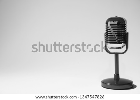 Retro microphone on light background. Space for text #1347547826