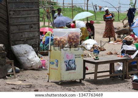Gisenyie, Rwanda, 11-10-2018. Market in Gisenyie. People selling Fruits, Vegetable and fish. Rwanda, Africa #1347763469