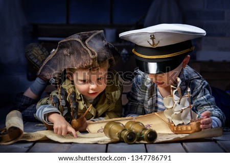 Two boys, a pirate and a sailor, played in a naval battle in his room #1347786791