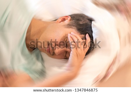 Vertigo illness concept. Man hands on his head felling headache dizzy sense of spinning dizziness,a problem with the inner ear, brain, or sensory nerve pathway. #1347846875