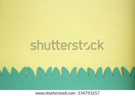 On wall decorative grass, vegetation and nature with space for text