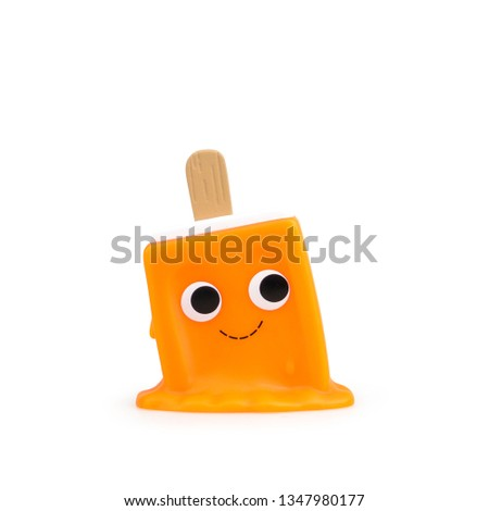 Children's cute toy food ice cream with a smile on a white background