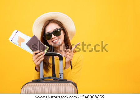 Tourist asian woman smile happily on the yellow background. #1348008659