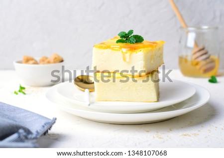 Custard Pudding, Delicious Custard Dessert Served with Honey, Homemade Semolina Cake #1348107068