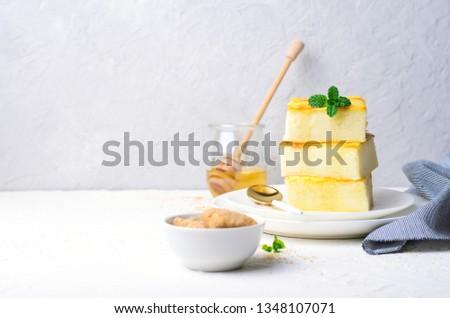 Custard Pudding, Delicious Custard Dessert Served with Honey, Homemade Semolina Cake #1348107071