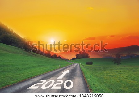 Empty asphalt road and New year 2020 concept. Driving on an empty road on goals in the mountains to upcoming 2020 and leaving behind old years. Concept for growth success, passing time and future. #1348215050