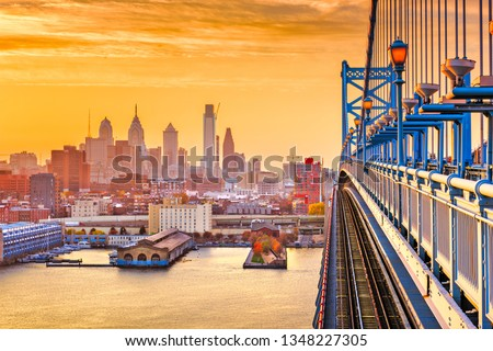 Philadelphia, Pennsylvania, USA downtown skyline from the Benjamin Franklin Bridge at twilight.  #1348227305