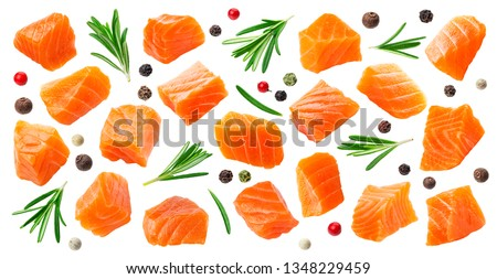 Salmon slices isolated on white background with clipping path, cubes of red fish with rosemary and peppercorns, ingredient for sushi or salad, macro #1348229459