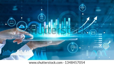 Businessman using tablet analyzing sales data and economic growth graph chart. Business strategy. Abstract icon. Digital marketing. #1348457054
