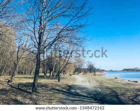 the walk in the park in the early spring.  The park is surrounded by water and paths to stroll and enjoy the view of Nesvizh Castle which was owned by the Radziwill which is connected to JFK via his #1348472162