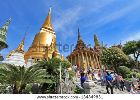 BANGKOK THAILAND - JAN 03 : Many people go to the Grand Palace  (also called Wat Phra Kaew) on January 03, 2013 in Bangkok, Thailand. #134849831